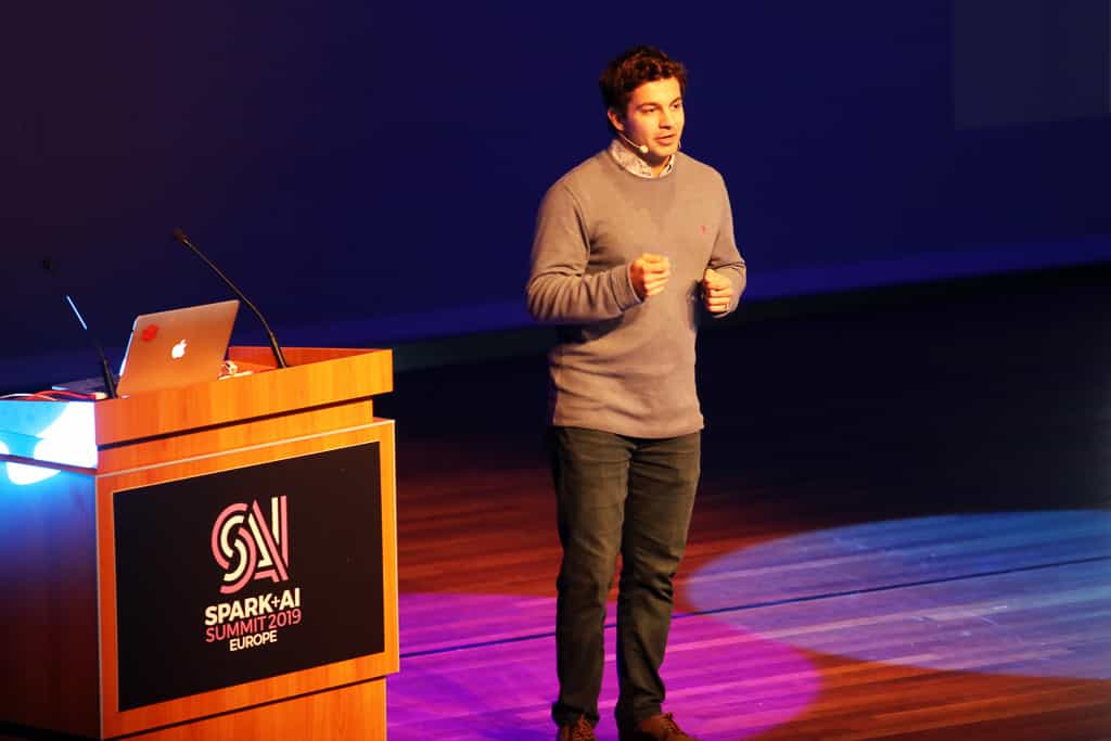 Burak Yavuz demos Delta Lake onstage at Spark Summit Europe 2019 in Amsterdam.